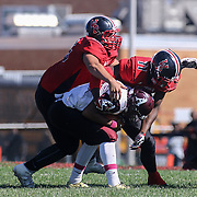 Appoquinimink quarter back Kenyon Yellowdy (3) is sacked by William Penn defender Myles Goodson (11) in the second quarter Saturday, Oct. 10, 2015 at Bill Cole Stadium in New Castle, DE.