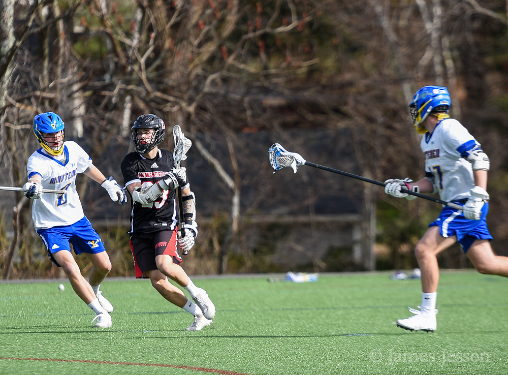 Winchester High School senior Steven Osborne III moves the ball up the field during the game against Lexington High School in Lexington, April 24, 2018. Winchester won the game, 11-6.   [Wicked Local Photo/James Jesson]