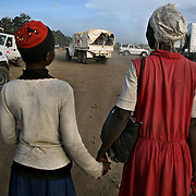 A Luo mother and daughter wait their turn to be evacuated to safety by the Kenyan Red Cross after two days of brutal ethnic violence in Nakuru. Photo by Evelyn Hockstein for The New York Times. January 26, 2008.