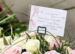 © Licensed to London News Pictures. 22/10/2011. Manchester, UK. Flowers left from Julie Goodyear at the funeral of former Coronation Street actress Betty Driver at St Ann's Church in Manchester. The actress lived to the age of 91. Photo credit : Joel Goodman/LNP