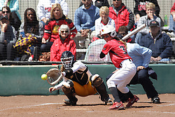 26 April 2015:   At bat for the Redbirds is Kelsey Turczyn catching for the Ramblers is Annie Korth during an NCAA Missouri Valley Conference (MVC) Championship series women's softball game between the Loyola Ramblers and the Illinois State Redbirds on Marian Kneer Field in Normal IL