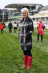 © Licensed to London News Pictures. 08/04/2016. Liverpool, UK. Judy Murray, mother of tennis player Andy Murray, walks the course in her red wellies on Ladies Day at the Grand National 2016 at Aintree Racecourse near Liverpool. The race, which was first run in 1839, is the most valuable jump race in Europe. Photo credit : Ian Hinchliffe/LNP
