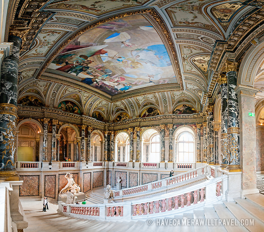 Wide-angle, panoramic shot of the interior of the main entrance stairway of the Kunsthistoriches Museum