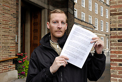© Licensed to London News Pictures. 18/10/2013. Bristol, UK.  Picture of Michael Phelps, a resident with Bristol Foundation Housing, outside City Hall to present a statement on behalf of the Bristol Foundation Housing Residents Association (BFHRA) to Bristol City Council's Resources Scrutiny Committee.  Bristol Foundation Housing residents are threatened with being made homeless as 7 out of 9 hostels run by the housing charity are threatened with closure.  BFH has gone into administration after a disagreement with Bristol City Council over levels of housing benefit for the Exempt Accommodation which enables the network of 9 BFH hostels to provide staffing and the high level of support that these vulnerable residents need.  The BFHRA statement says that some of the residents feel desperate and that they will end up dead or in prison.  The Council carried out a review of BFH but the residents do not think the team were skilled in assessing their needs and the review which contained some personal information was not shared with the charity or residents but given to the media.  BFHRA say that Bristol City Council is ideologically opposed to Exempt Accommodation, will not negotiate with BFH and uses the tribunal service for Exempt Accommodation more than any other local authority.  Other large city councils have been looking at cutting exempt accommodation costs and Bristol is one of the first to take action. 18 October 2013.<br /> Photo credit : Simon Chapman/LNP