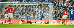 LONDON, ENGLAND - Saturday, April 18, 2009: Arsenal's Theo Walcott scores the opening goal past Chelsea's goalkeeper Petr Cech during the FA Cup Semi-Final match at Wembley. (Photo by: David Rawcliffe/Propaganda)