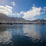 Sunny day on Hout Bay harbor, Cape Town area, South Africa.