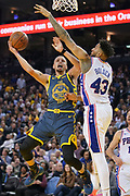 January 31, 2019; Oakland, CA, USA; Golden State Warriors guard Stephen Curry (30) shoots the basketball against Philadelphia 76ers forward Jonah Bolden (43) during the third quarter at Oracle Arena.