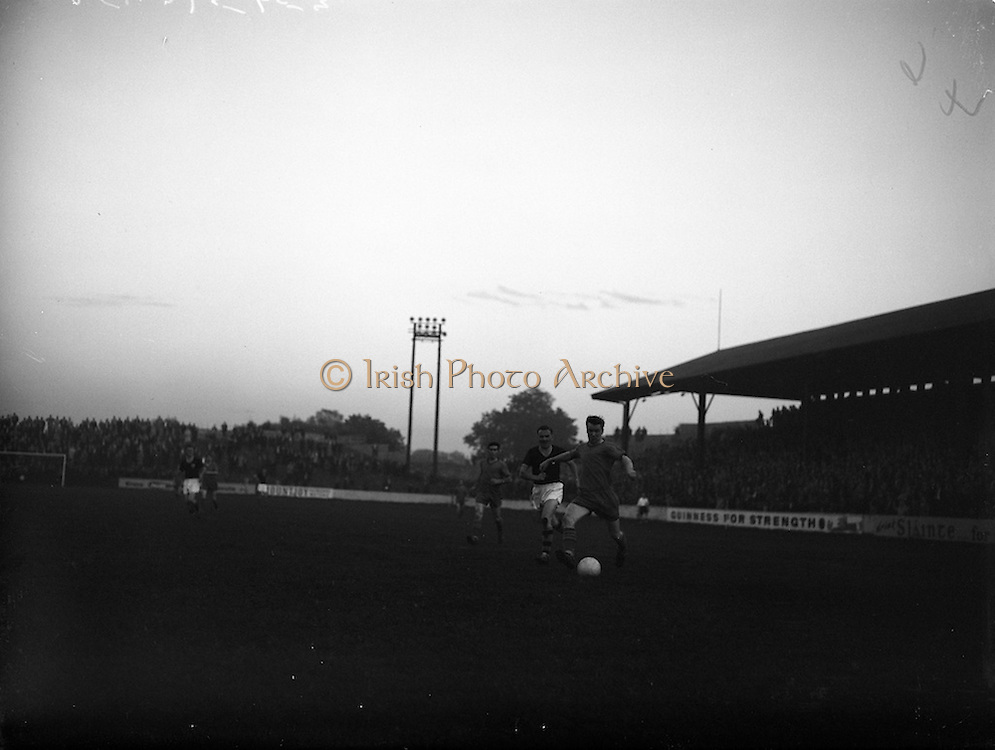 07/09/1960<br /> 09/07/1960<br /> 07 September 1960<br /> Soccer: City Cup Final, Drumcondra v Cork Celtic at Tolka Park, Dublin. Drumcondra centre forward Mccaffery in possession, is pressed by Cork full back O'Keefe as he nears the Celtic goal.