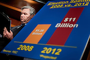 """Senator SHELDON WHITEHOUSE (D-RI) looks over his notes during a press conference to announce new legislation """"to blunt the worst effects"""" of the Supreme Court's Citizens United v. Federal Election Commission decision on Capitol Hill Wednesday."""