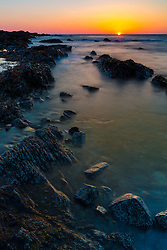 Dawn on the rocky shoreline of Wallis Sands State Park in Rye, New Hampshire.