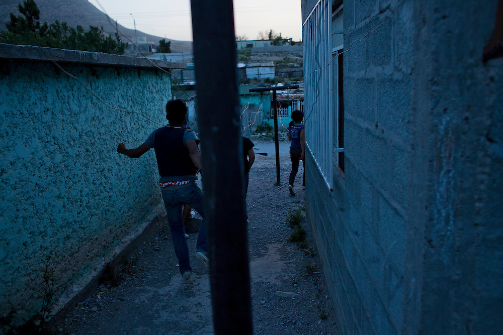 A group of teenagers chases each other for fun in the Diaz Ordaz colonia in Ciudad Juarez, Chihuahua Mexico on April 28, 2010. .