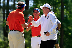 Gary Stokan celebrates with Dan Mullen during the Chick-fil-A Peach Bowl Challenge at the Oconee Golf Course at Reynolds Plantation, Sunday, May 1, 2018, in Greensboro, Georgia. (Paul Abell via Abell Images for Chick-fil-A Peach Bowl Challenge)