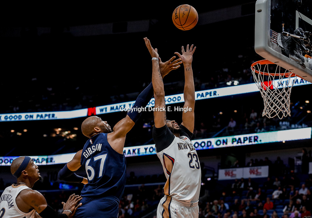 Nov 1, 2017; New Orleans, LA, USA; New Orleans Pelicans forward Anthony Davis (23) rebounds over Minnesota Timberwolves forward Taj Gibson (67) during the first quarter of a game at the Smoothie King Center. Mandatory Credit: Derick E. Hingle-USA TODAY Sports