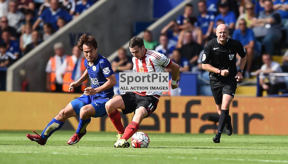 Adam Johnson shileds the ball from the energetic Shinji Okazaki (c) Simon Kimber | SportPix.org.uk