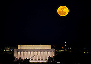 """A perigee moon rises over the Lincoln Memorial in Washington, D.C. shorty after sunset on Saturday night. The perigee moon appears so large because it is at the """"perigee"""" point in its orbit around earth, the closest point in the orbit's ellipse. """"The full Moon of March 19th occurs less than one hour away from perigee,"""" says Geoff Chester of the U.S. Naval Observatory  """"a near-perfect coincidence that happens only every 18 years or so."""""""