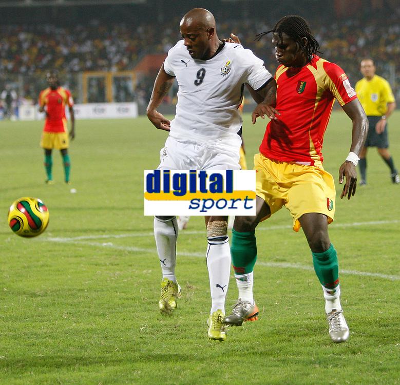 Photo: Steve Bond/Richard Lane Photography.<br />Ghana v Guinea. Africa Cup of Nations. 20/01/2008. Junior Agogo (L) shields the ball