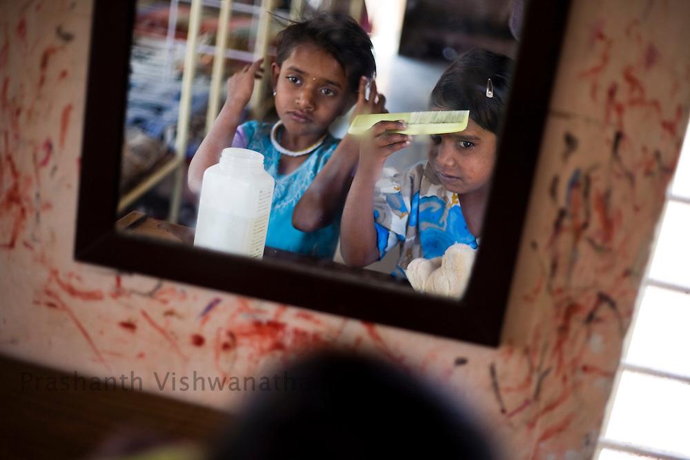 Lakshmi Khandogi, Age: 7yrs (L), Puja Kamankar Age 9 yrs.   suffering from AIDS looks on in an orphanage in Ahmednagar Maharashtra. Photographer: Prashanth Vishwanathan