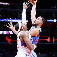 02 October 2015: Denver Nuggets forward Joffrey Lauvergne (77) goes for the skyhook over Los Angeles Clippers forward Paul Pierce (34) during the Los Angeles Clippers 103-96 victory over the Denver Nuggets, in a preseason game, at the Staples Center, Los Angeles, California, USA.