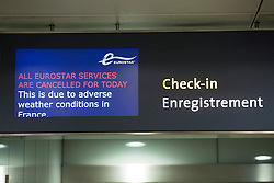 © licensed to London News Pictures. London, UK 12/03/2013. An information board shows the cancelled Eurostar services at St Pancras Station in London due to weather conditions in north of France. Photo credit: Tolga Akmen/LNP