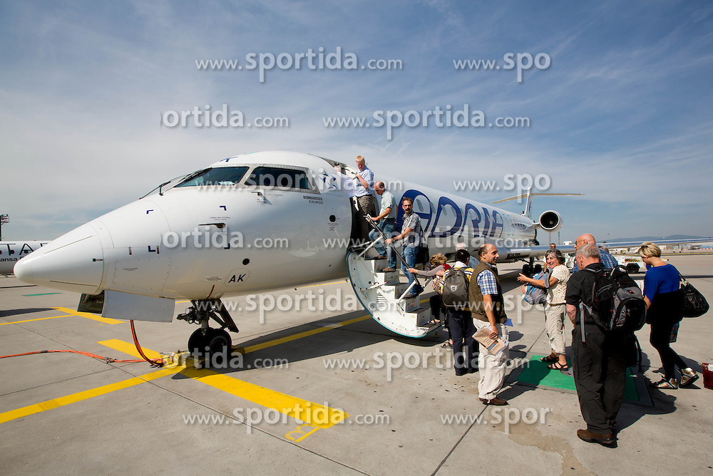 Airplane of Adria Airways at Airport in Frankfurt during way back of Team Slovenia to Airport Joze Pucnik after the London 2012 Paralympic Games on September 10, 2012, in Frankfurt, Germany. (Photo by Vid Ponikvar / Sportida.com)