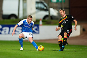 Partick Thistle midfielder Chris Erskine (#10) plays the ball back under pressure from St Johnstone defender Brian Easton (#24) during the Betfred Scottish Cup match between St Johnstone and Partick Thistle at McDiarmid Stadium, Perth, Scotland on 8 August 2017. Photo by Craig Doyle.