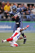 SEATTLE - NOVEMBER 28:  Free safety Ken Hamlin #26 of the Seattle Seahawks gets tackled by a Buffalo Bills player after pulling down one of his two interceptions for the day at Qwest Field on November 28, 2004 in Seattle, Washington. The Bills defeated the Seahawks 38-9. ©Paul Anthony Spinelli *** Local Caption *** Ken Hamlin