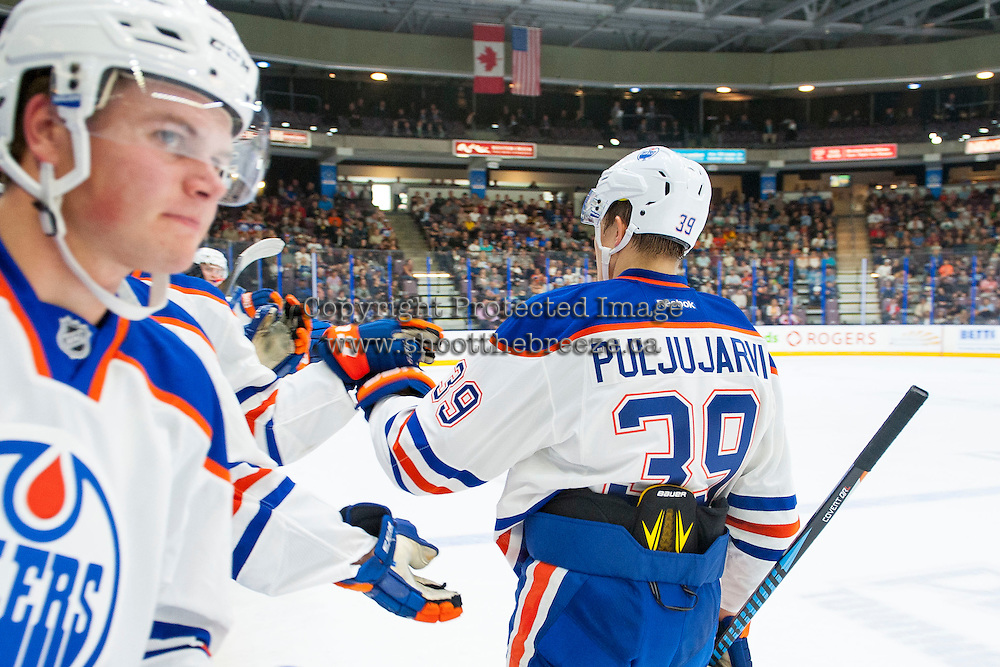 PENTICTON, CANADA - SEPTEMBER 16: Jesse Puljujarvi #39 of the Edmonton Oilers celebrates a goal against the Vancouver Canucks on September 16, 2016 at the South Okanagan Event Centre in Penticton, British Columbia, Canada.  (Photo by Marissa Baecker/Shoot the Breeze)  *** Local Caption *** Jesse Puljujarvi;