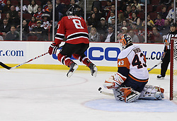 Apr 10, 2010; Newark, NJ, USA; New York Islanders goalie Martin Biron (43) makes a save through a screen by New Jersey Devils center Dainius Zubrus (8) during the third period at the Prudential Center. The Devils defeated the Islanders 7-1.