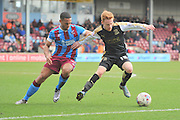 James Brophy (15) of Swindon Town and Jordan Clarke of Scunthorpe United  during the Sky Bet League 1 match between Scunthorpe United and Swindon Town at Glanford Park, Scunthorpe, England on 28 March 2016. Photo by Ian Lyall.