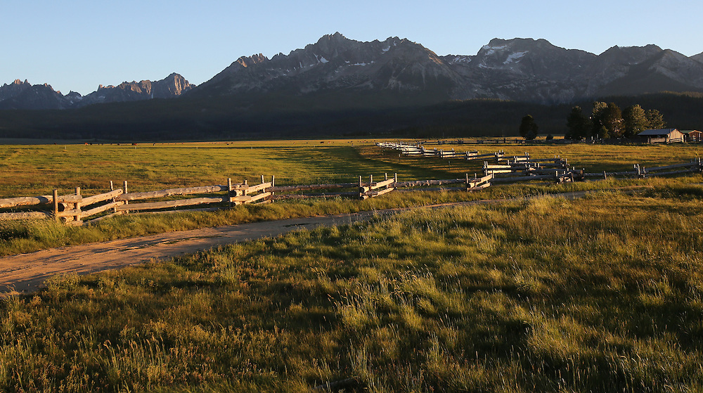 The sun sets on the Sawtooth Mountains in central Idaho near the town of Stanley on Saturday July 13, 2013.
