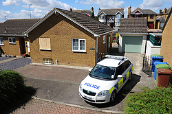&copy; Licensed to London News Pictures. 31/07/2018<br /> KEMSLEY, UK.<br /> Police outside the property.<br /> A man has been arrested on suspicion of murder after a woman's body is found at a property in Hurst Lane, Kemsley near Sittingbourne. Police had to smash a window to get access to the property, police are on scene. <br /> Photo credit: Grant Falvey/LNP
