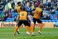 Eoin Doyle of Cardiff City shoots into Richard Stearman of Wolverhampton Wanderers - Photo mandatory by-line: Rogan Thomson/JMP - 07966 386802 - 28/02/2015 - SPORT - FOOTBALL - Cardiff, Wales - Cardiff City Stadium - Cardiff City v Wolverhampton Wanderers - Sky Bet Championship.