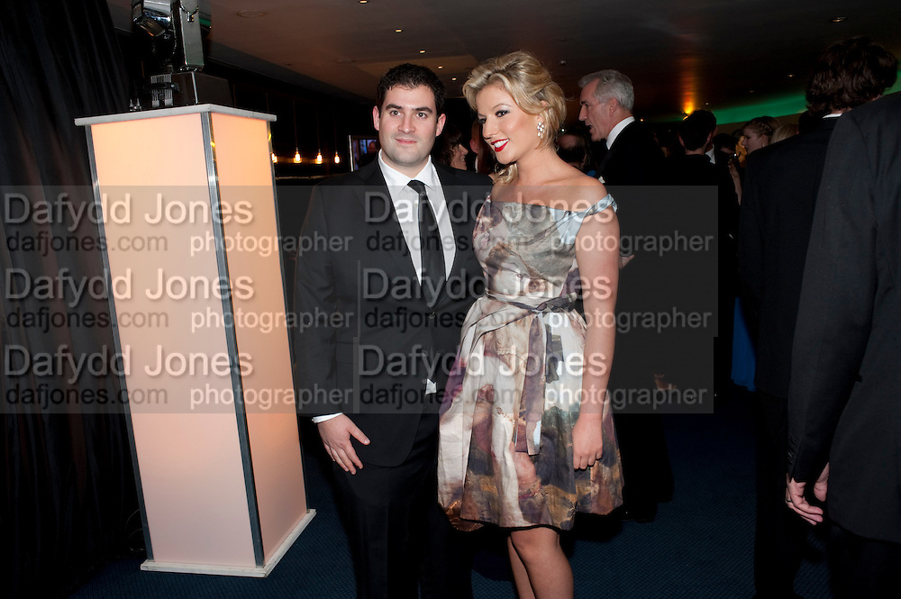 NATALIE COYLE; ZAFAR RUSHDIE; , GQ Men of the Year awards. The royal Opera House. Covent Garden. London. 6 September 2011. <br /> <br />  , -DO NOT ARCHIVE-© Copyright Photograph by Dafydd Jones. 248 Clapham Rd. London SW9 0PZ. Tel 0207 820 0771. www.dafjones.com.