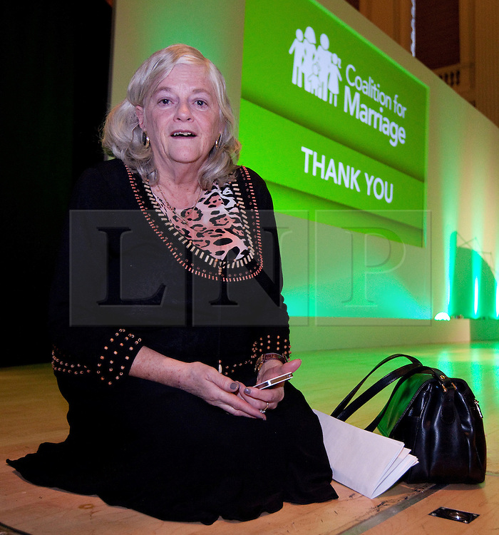 © Licensed to London News Pictures. 08/10/2012. Birmingham , UK . Conservative MP for Maidstone and The Weald , Ann Widdecombe , kneels on the stage . Birmingham Town Hall meeting of The Coalition for Marriage , who are opposed to giving marriage rights to gay people . Photo credit : Joel Goodman/LNP