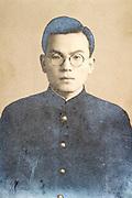 jong adult man in school uniform looking at the camera deteriorating portrait Japan ca 1940s