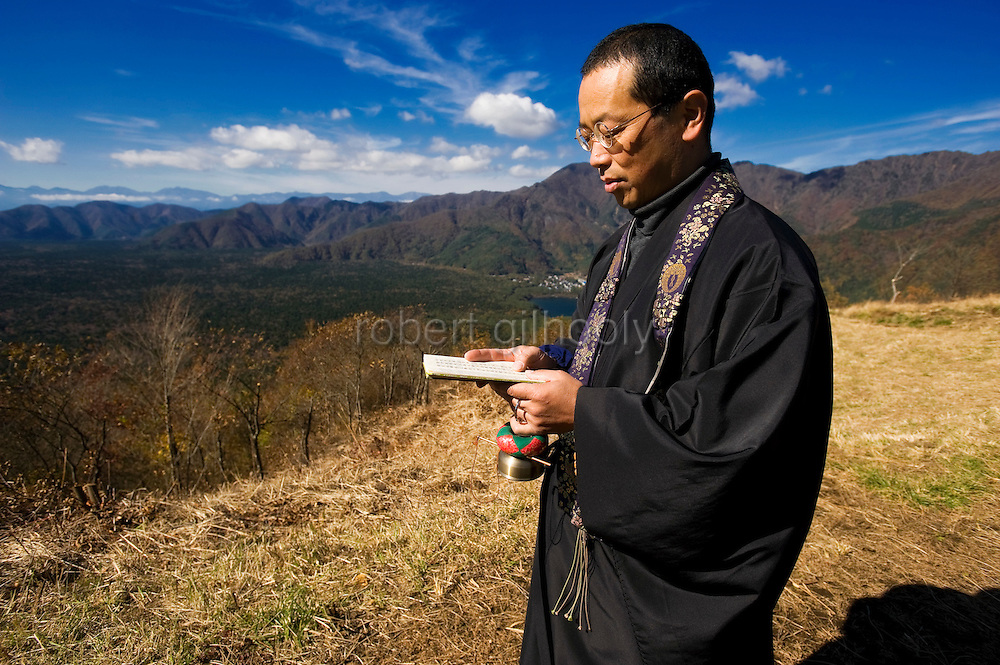 A priest of the Jodo Shinshu sect of Buddhism, offers prayer for those who committed suicide in Aokigahara Jukai, better known as the Mt. Fuji suicide forest, in Yamanashi Prefecture, west of Tokyo, Japan on 04 Nov. 2009.
