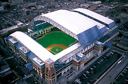 Stock photo of an aerial view of Minute Maid Park with the roof open.
