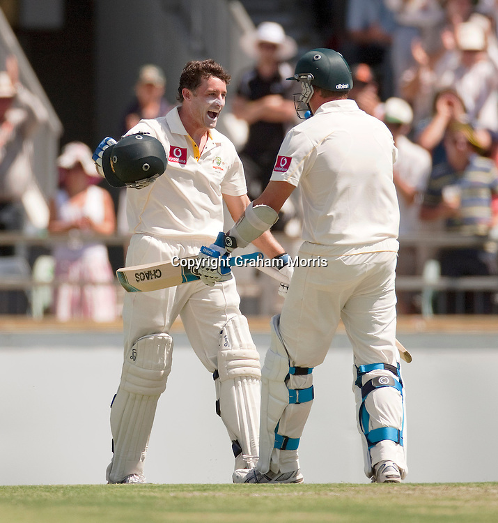 Michael Hussey celebrates his century (with Ryan Harris, right) during the third Ashes test match between Australia and England at the WACA (West Australian Cricket Association) ground in Perth, Australia. Photo: Graham Morris (Tel: +44(0)20 8969 4192 Email: sales@cricketpix.com) 18/12/10