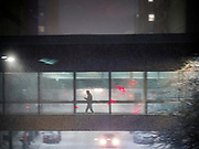 10 JANUARY 2020 - DES MOINES, IOWA: A person uses the skywalk to get across a street during a snowstorm in downtown Des Moines Friday. The first significant snow in two months blanketed Des Moines Friday evening. Meteorologists are predicting up to six inches of snow overnight and have issued a winter storm warning for southern and central Iowa. Most schools in the affected area closed early and cancelled afternoon events. Some presidential candidates, campaigning ahead of the Iowa Caucuses, cancelled their events.      PHOTO BY JACK KURTZ