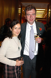 MISS LILY JOHNSTON and MR DAVID KESWICK at an aution of art inspired by footballer David Beckham in aid of The National Deaf Children's Society and held at Christie's, St.James's, London on 4th November 2004.<br /><br />NON EXCLUSIVE - WORLD RIGHTS