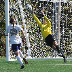 Photos by Tom Kelly IV<br /> WCU goalkeeper Alex Srolis (1) can't come up with the save on this shot, but luckily for her it rings off the goal post, and deflected away from the goal, as defender Rachel Jackson (23) looks on during the Indiana University of Pennsylvania (IUP) vs West Chester University (WCU) women's soccer game in East Bradford Township, Wednesday afternoon October 2, 2013.