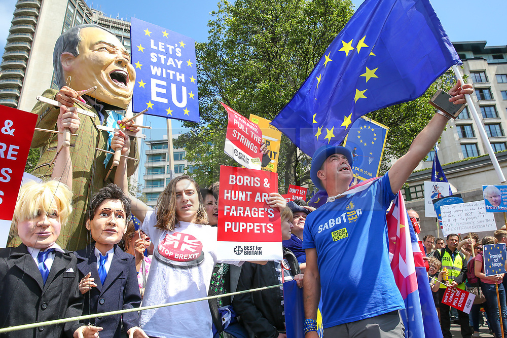 "© Licensed to London News Pictures. 20/07/2019. London, UK. STEVE BRAY (R) and Pro EU demonstrators take part in the ""No to Boris. Yes to Europe"" march in central London. Photo credit: Dinendra Haria/LNP"