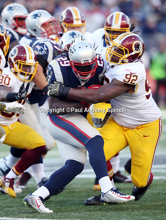 New England Patriots running back LeGarrette Blount (29) gets tackled by Washington Redskins defensive end Chris Baker (92) as he runs the ball in the third quarter during the 2015 week 9 regular season NFL football game against the Washington Redskins on Sunday, Nov. 8, 2015 in Foxborough, Mass. The Patriots won the game 27-10. (©Paul Anthony Spinelli)