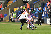 Reading Midfielder,  Jordan Obita  and Bolton Wanderers Defender Niall Maher in action during the Sky Bet Championship match between Bolton Wanderers and Reading at the Macron Stadium, Bolton, England on 2 April 2016. Photo by Mark Pollitt.