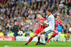 May 2, 2018 - Madrid, Spain - MADRID, SPAIN. May 1, 2018 - Lewandosky and Varane. With a 2-2 draw against Bayern Munchen, Real Madrid made it to the UEFA Champions League Final for third time in a row. Kimmich and James scored for the german squad while Karim Benzema did it twice for los blancos. Goalkeeper Keylor Navas had a great night with several decisive interventions. (Credit Image: © VW Pics via ZUMA Wire)