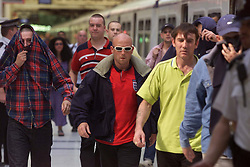Liverpool St Stn, soccer thugs arrive on trains from Stansted airport, June 18, 2000. Photo by Andrew Parsons / i-images..
