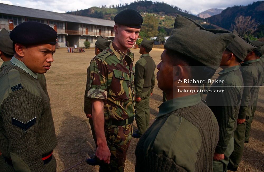 New recruits of the British Royal Gurkha Regiment parade before taking official oaths on the Union Jack flag at their army camp in Pokhara, Nepal after recently being recruited into the regiment after a gruelling series of tests to eliminate the weaker and less able candidates, before the 160 lucky candidates travel to the UK for basic training. 60,000 boys aged between 17-22 (or 25 for those educated enough to become clerks or communications specialists) report to designated recruiting stations in the hills each November, most living from altitudes ranging from 4,000-12,000 feet. After initial selection, 7,000 are accepted for further tests from which 700 are sent down here to Pokhara in the shadow of the Himalayas. Nepal has been supplying youth for the British army since the Indian Mutiny of 1857.