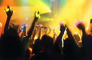Crowd with hands in the air, clubbing, UK 1997