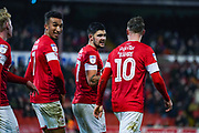 Barnsley midfielder Mike-Steven Bahre (10) scores a goal and celebrates with Barnsley midfielder Alex Mowatt (27)  to make the score 2-0 during the EFL Sky Bet Championship match between Barnsley and Hull City at Oakwell, Barnsley, England on 30 November 2019.