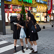 TOKYO, JAPAN - OCTOBER 20 : A high school students taking selfie in Kabukicho, Shinjuku district Tokyo, Japan on October 20, 2015. <br /> <br /> Photo: Richard Atrero de Guzman